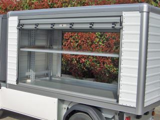 Roller shutter van box for utility vehicle